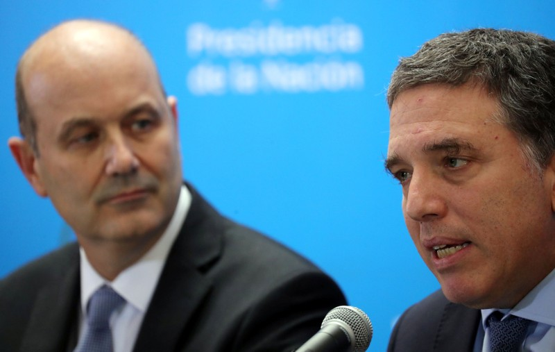 Argentina's Treasury Minister Dujovne speaks next to Argentina's Central Bank President Sturzenegger during a news conference in Buenos Aires