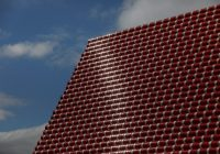 Artist Christo floats tomb of barrels in London's Hyde Park