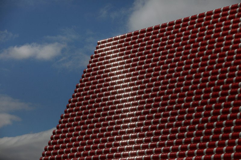 The sun reflects on oil barrels that make up Christo's work The London Mastaba, on the Serpentine in Hyde Park, London, Britain