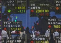 Asian shares mixed after Trump's latest trade comments; yen strengthens