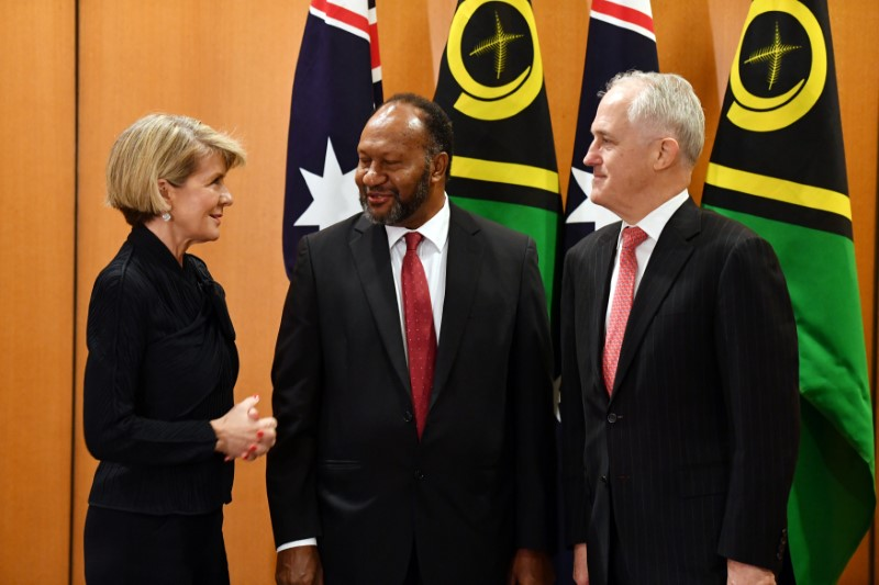 Australian Foreign Minister Julie Bishop speaks to Vanuatu Prime Minister Charlot Salwai and Australian Prime Minister Malcolm Turnbull before a bilateral meeting at Parliament House in Canberra