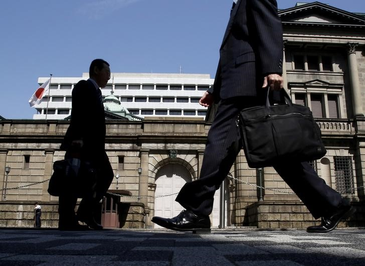 FILE PHOTO - People walk on a street in front of the Bank of Japan headquarters in Tokyo