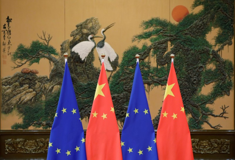 FILE PHOTO: Flags of European Union and China are pictured during the China-EU summit in Beijing