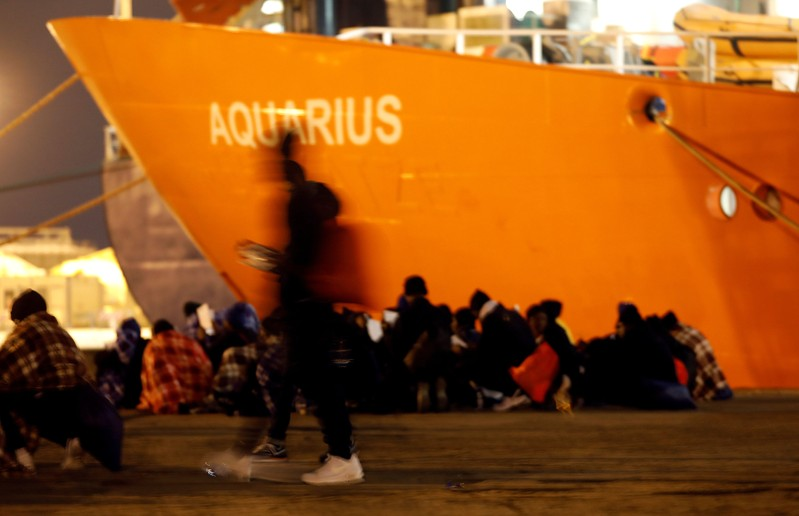FILE PHOTO: Migrants disembark from the MV Aquarius after its arrivalgen in Sicily in January