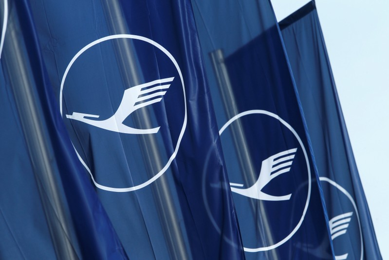 FILE PHOTO: Flags with the German airline Lufthansa sign flutter next to the office building in Frankfurt