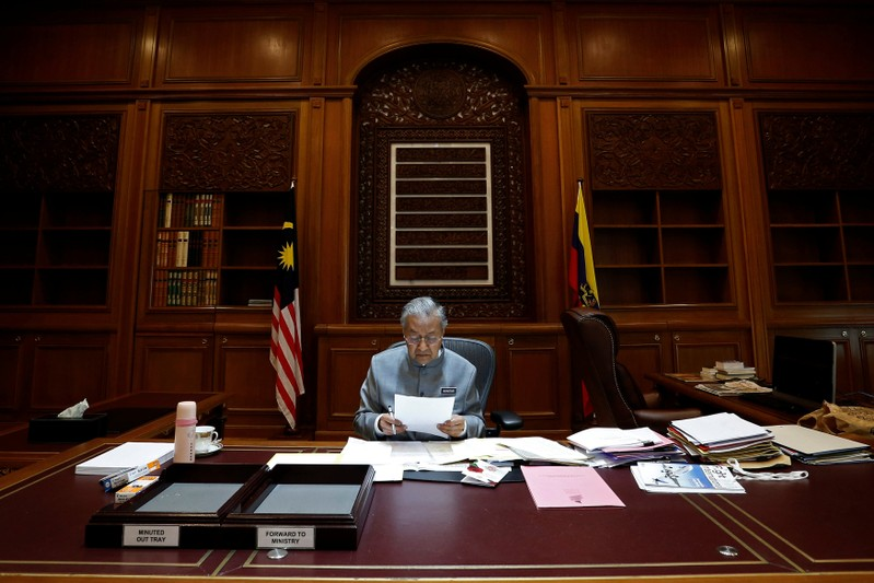 Malaysia's Prime Minister Mahathir Mohamad works at his office in Putrajaya