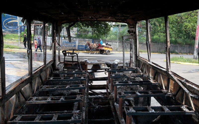 A burned bus is seen during a protest against Nicaragua's President Daniel Ortega's government at neighborhood in Managua