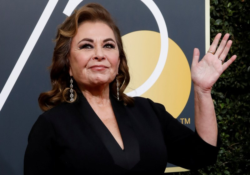 FILE PHOTO: Actress Roseanne Barr waves on her arrival to the 75th Golden Globe Awards in Beverly Hills