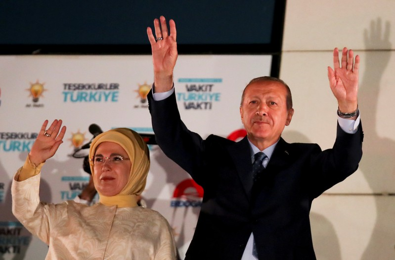 Turkish President Tayyip Erdogan and his wife Emine Erdogan greet supporters gathered in front of the AKP headquarters in Ankara