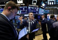 Wall Street ends modestly lower but energy shares rise