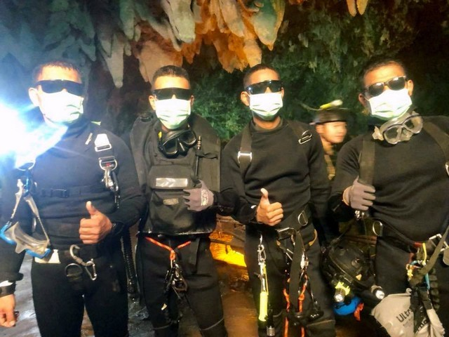 Four Thai Navy Seals are seen after leaving the cave during the rescue mission in Chiang Rai