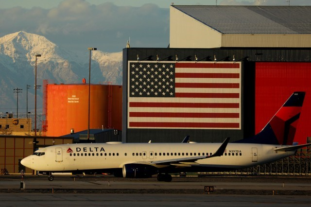 FILE PHOTO: A Delta Air Lines Boeing 737 plane arrives in Salt Lake City