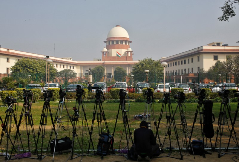 FILE PHOTO: A television journalist sets his camera inside the premises of the Supreme Court in New Delhi