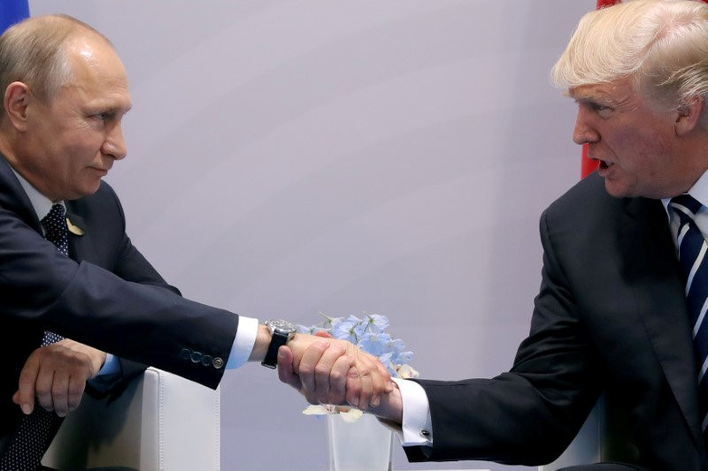 FILE PHOTO: FILE PHOTO: U.S. President Trump shakes hands with Russian President Putin during the their bilateral meeting at the G20 summit in Hamburg