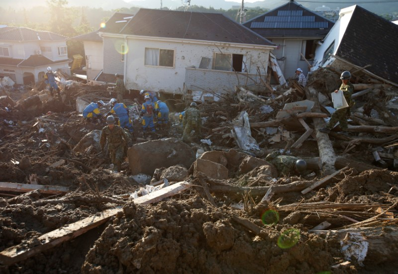 Rescue workers and soldiers search for missing people at a landslide site in Kumano Town