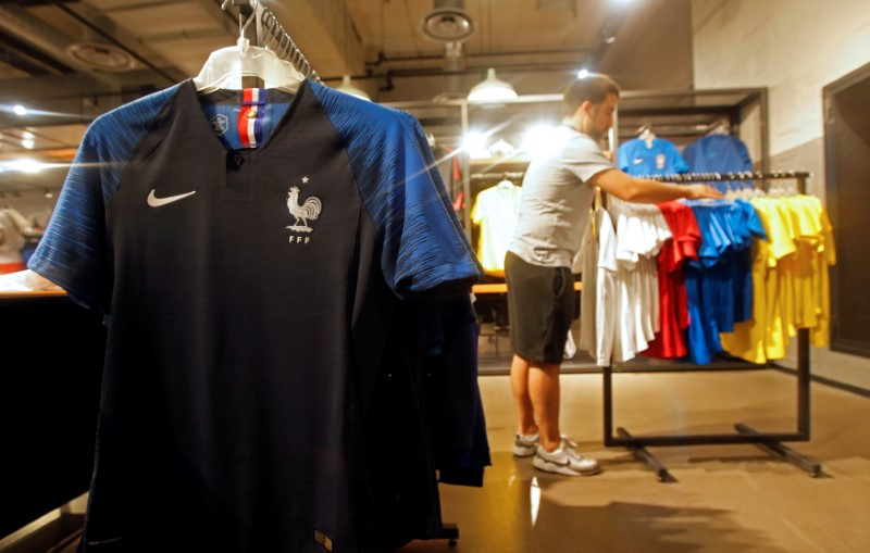 France team soccer jerseys are displayed in a sporting goods store in Marseille