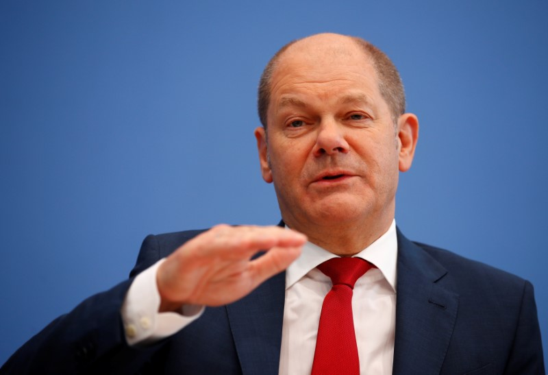 German Vice Chancellor and Finance Minister Olaf Scholz gestures during a news conference to present the fiscal plan for 2019-2022 in Berlin