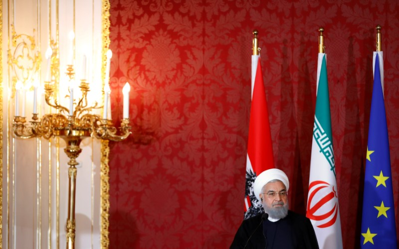 Iranian President Rouhani attends a news conference in Vienna