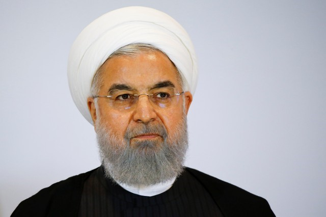 Iranian President Hassan Rouhani delivers a statement after a two day visit in Bern