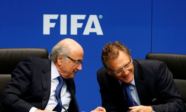 FILE PHOTO: Sepp Blatter talks to FIFA Secretary General Valcke during a news conference in Zurich