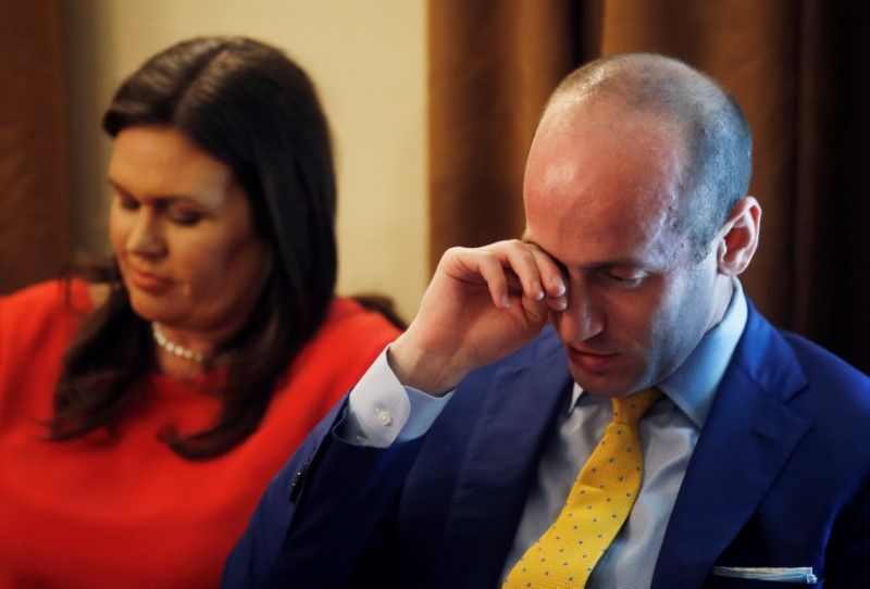 White House Press Secretary Sanders listens with adviser Miller as U.S. President Trump holds cabinet meeting at the White House in Washington