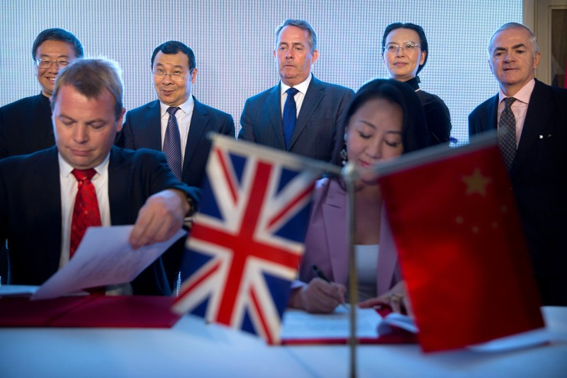 British Secretary of State for International Trade, Fox, attends signing ceremony in Beijing
