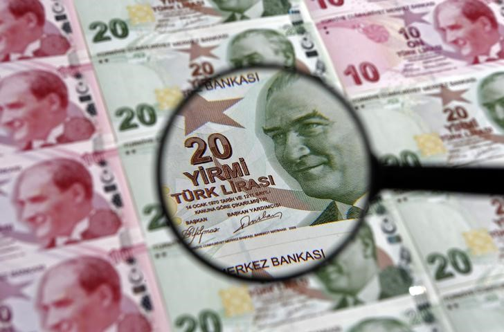 A 20 lira banknote is seen through a magnifying lens in this illustration picture taken in Istanbul