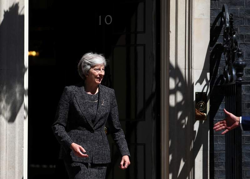 Britain's Prime Minister, Theresa May, greets Qatar's Emir Sheikh Tamim bin Hamad al-Thani on the doorstep of 10 Downing Street, London