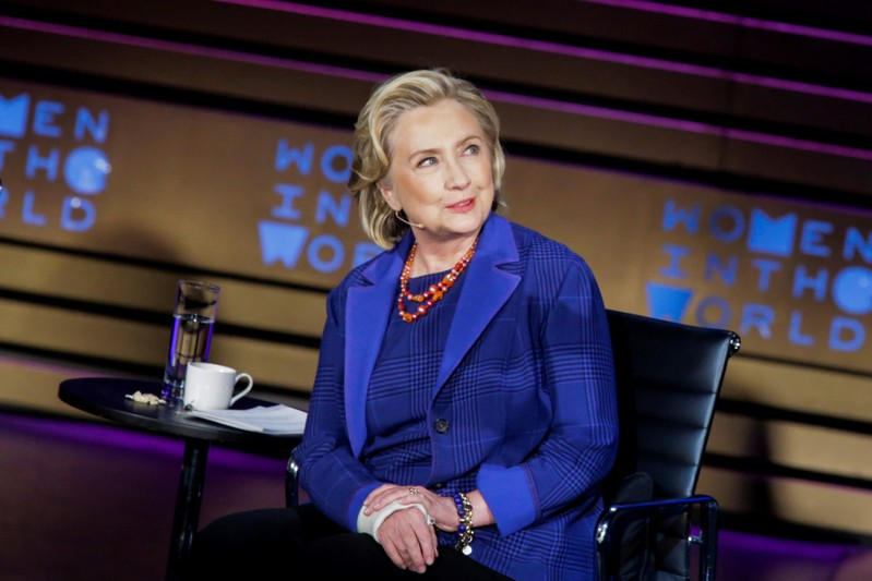 FILE PHOTO: Clinton, Former U.S. Secretary of State listens to Journalist Brown during the Women In The World Summit in New York