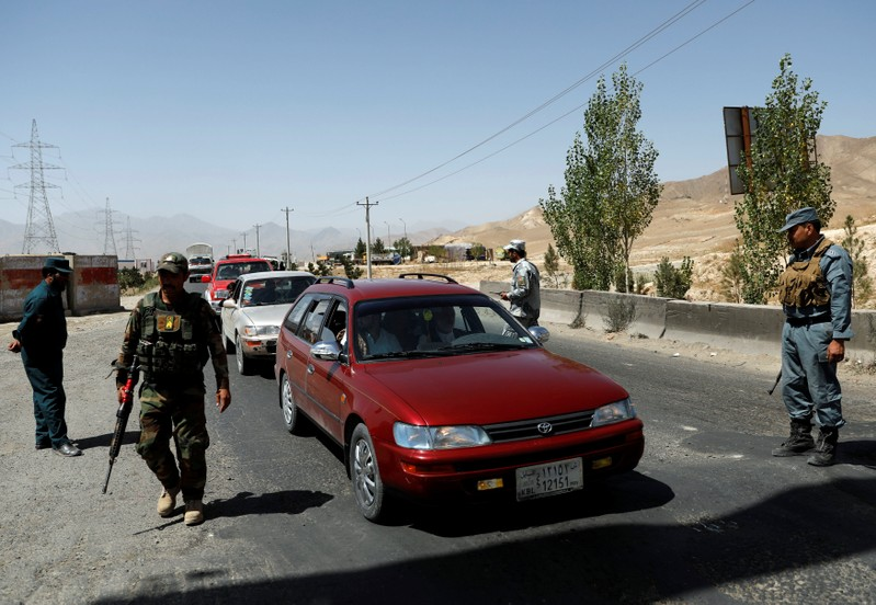 Afghan security forces keep watch at a checkpoint on the Ghazni highway, in Maidan Shar, the capital of Wardak province, Afghanistan