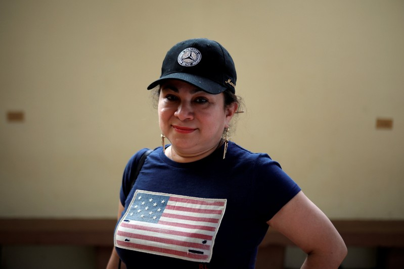 Emily Hernandez poses for a photograph before a ceremony to welcome Washington D.C. mayor Muriel Bowser in Intipuca, El Salvador