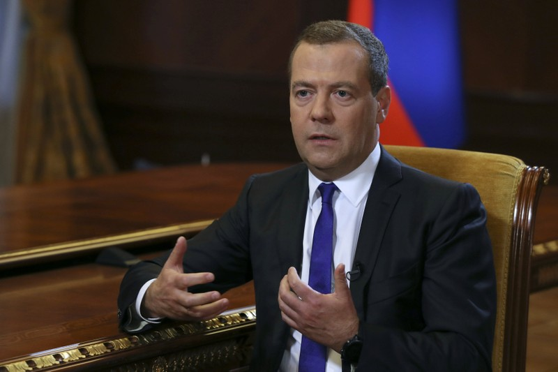 Russian PM Medvedev speaks during an interview with Russia's Kommersant newspaper at the Gorki state residence outside Moscow