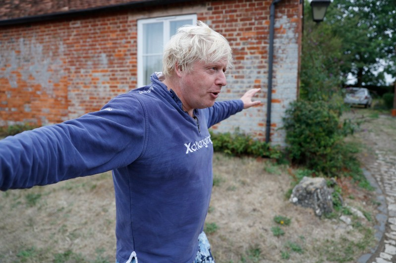 Britain's former Foreign Secretary Boris Johnson stands outside his home near Thame in Oxfordshire