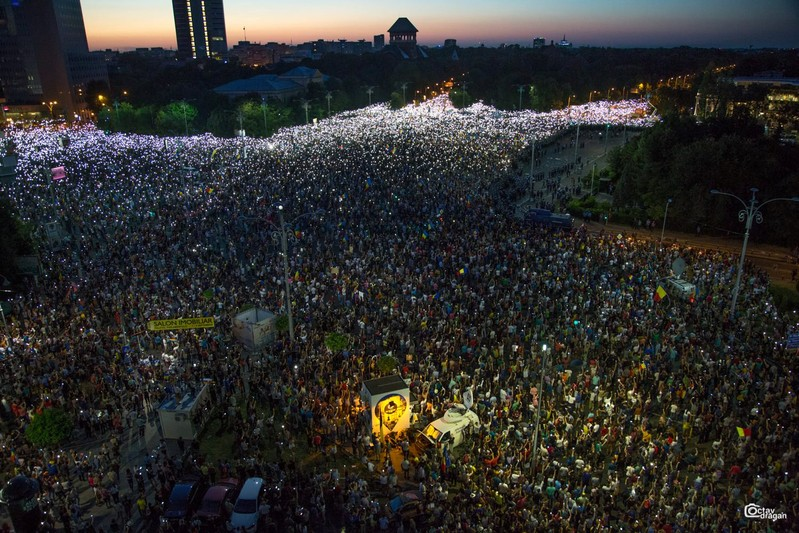 People attend a protest in Bucharest