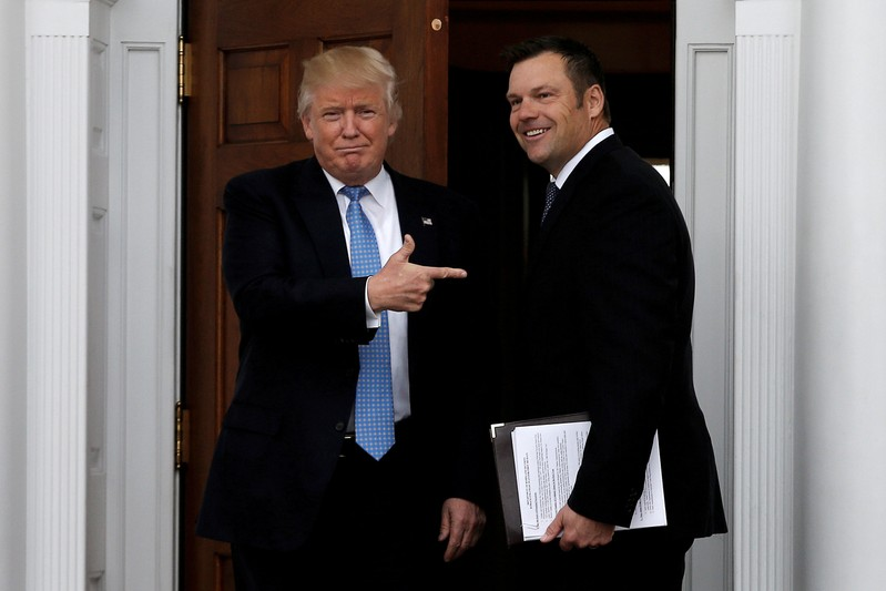 FILE PHOTO: U.S. President-elect Trump stands with Kansas Secretary of State Kobach before their meeting at Trump National Golf Club in Bedminster