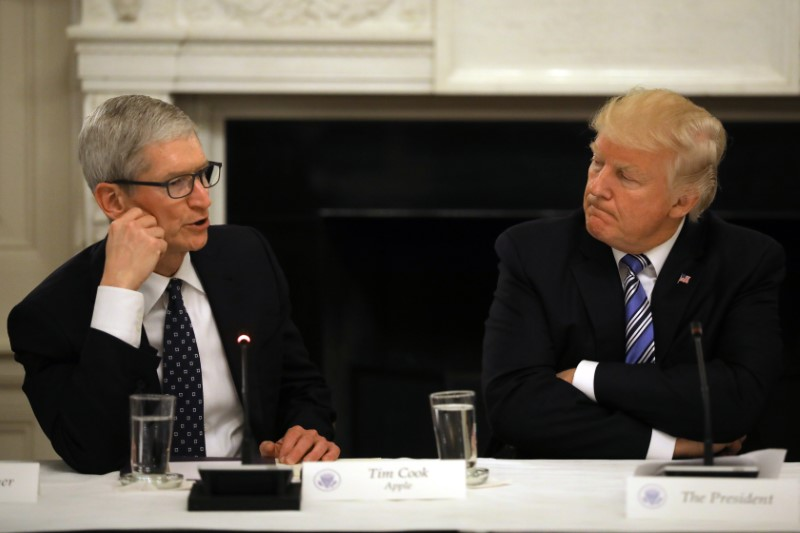 U.S. President Donald Trump listens as Tim Cook, CEO of Apple speaks during an American Technology Council roundtable at the White House in Washington, U.S.