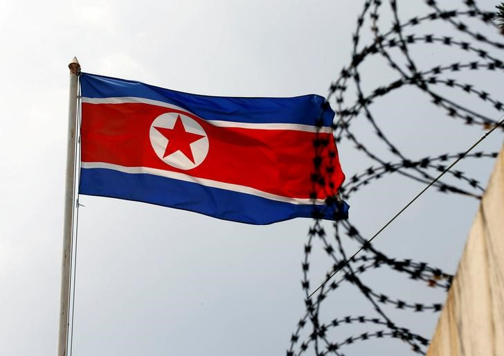 FILE PHOTO: The North Korea flag flutters next to concertina wire at the North Korean embassy in Kuala Lumpur