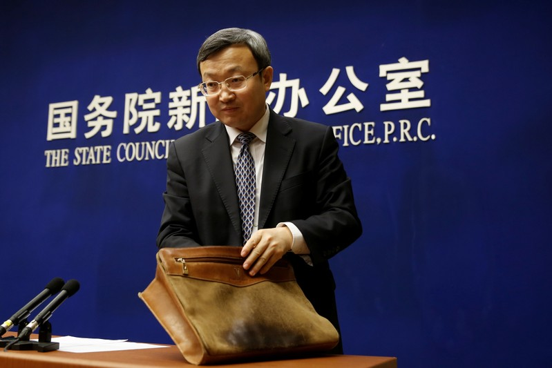 FILE PHOTO: Chinese Vice Commerce Minister and Deputy China International Trade Representative Wang Shouwen leaves a news conference in Beijing