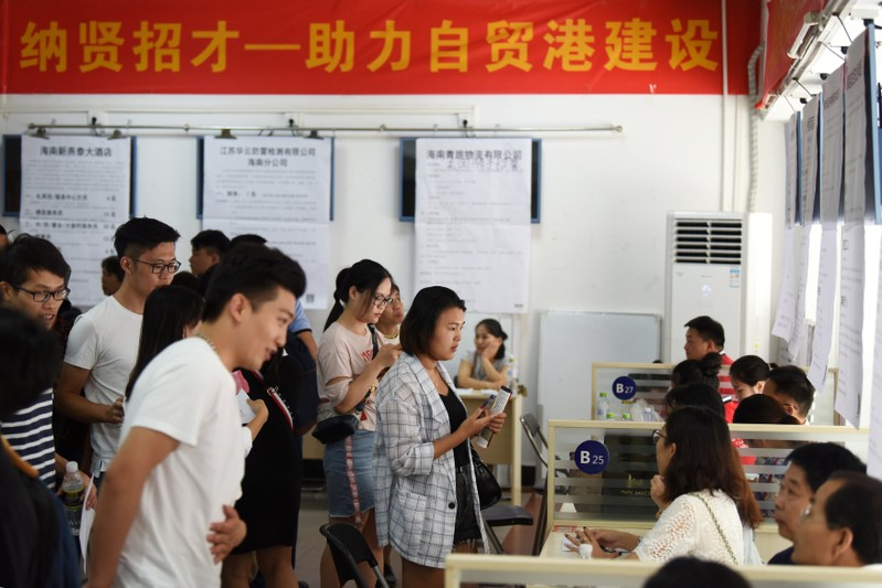 FILE PHOTO: Job seekers attend a job fair at the Human Resources Development Bureau of Hainan province in Haikou