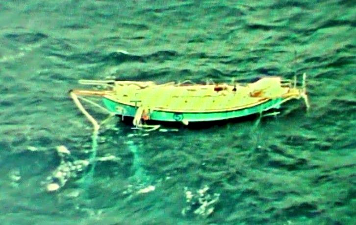 Indian Navy handout photo shows the capsized yacht Thuriya of solo sailor Abhilash Tomy at sea