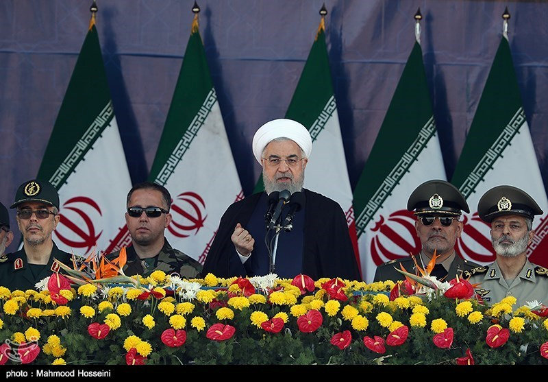 Iranian President Hassan Rouhani delivers a speech during the annual military parade in Tehran