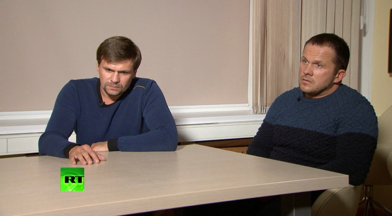 A still image shows two Russian men with the same names as those accused by Britain over Skripal case during an interview at an unidentified location