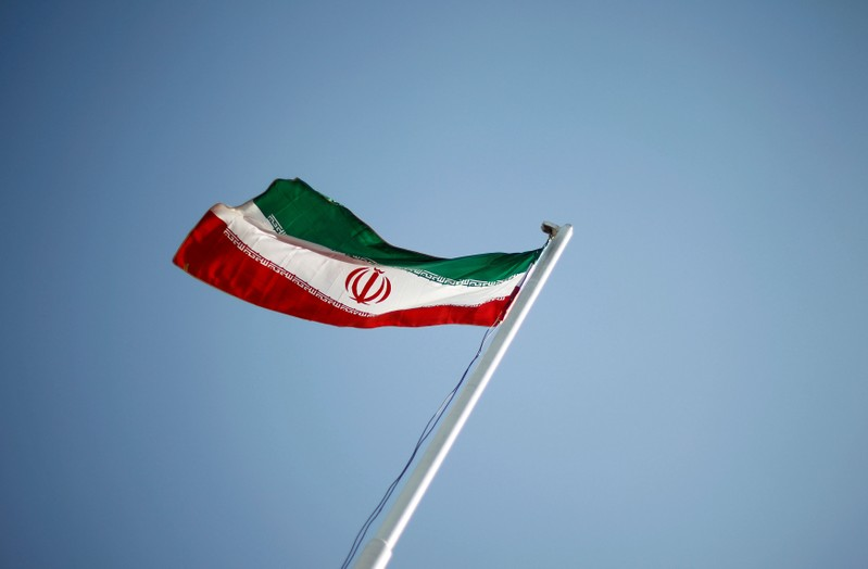 FILE PHOTO: File photo of an Iranian national flag during the opening ceremony of the 16th International Oil, Gas & Petrochemical Exhibition (IOGPE) in Tehran