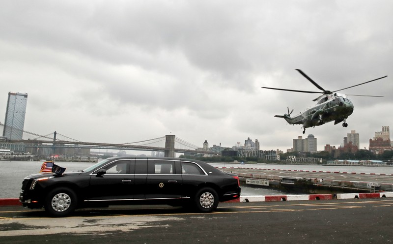 FILE PHOTO: Marine One carrying U.S. President Donald Trump lands behind his new Cadillac limousine in New York City