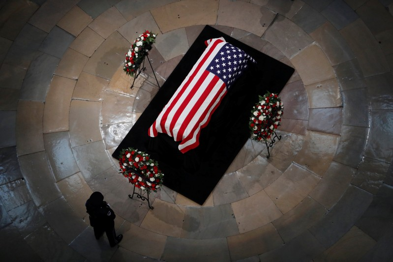 A casket with the body of late U.S. Senator McCain lies in state in the Rotunda at the U.S. Capitol in Washington