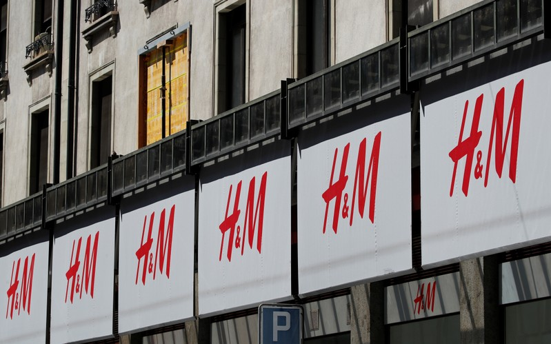 Logos of H&M are pictured on a store in Geneva