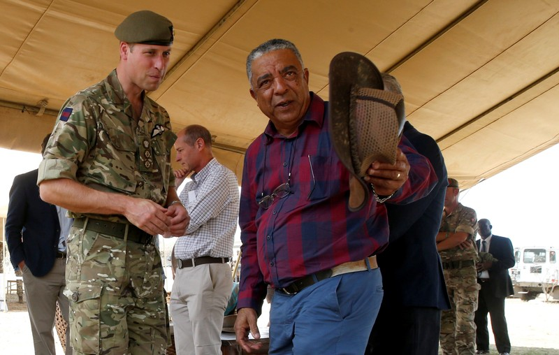 The Duke of Cambridge, Prince William listens to Laikipia Rancher Sammy Jessel during his visit to the British Army Training Unit Kenya in Laikipia
