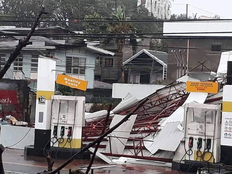 A damaged petrol station is seen as Typhoon Mangkhut hits Philippines