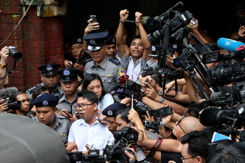 Detained Reuters journalists Wa Lone and Kyaw Soe Oo leave Insein court after listening to the verdict in Yangon