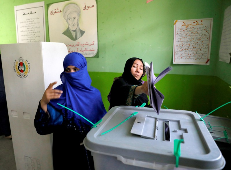 Afghan women cast their votes during parliamentary elections at a polling station in Kabul, Afghanistan